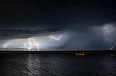 Storm on the estuary of the Gironde night in summer - France ; Thunderstorm kind MCS (meso-scale convective system) born on the Bay of Biscay and back on France in the night and hit Paris at dawn.