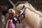 Little girl cuddling her pony - Senegal