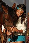 Girl harnessing his horse - Senegal