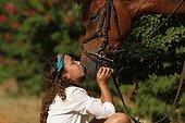 Young girl cuddling her horse - Senegal