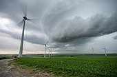 Storm front and wind turbines in the countryside - France
