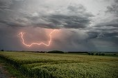 Cloudy flash in the back of a storm front - France