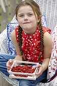 Girl with red currants