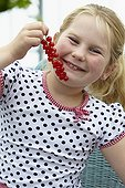 Girl eating red currants