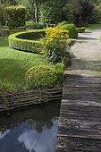 Wooden bridge over a garden pound