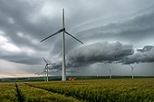 Wind turbines and storm front over the countryside - France