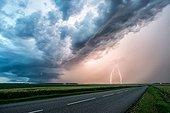 Supercell and lightning over the countryside - France ; Two positive lightnings are in hail precipitation.