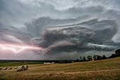 Thunderstorm and lightning above the evening countryside - France ; Architecture rarely seen cover.