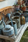 Watering cans in a city garden