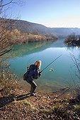 Femme pêchant une Perche en hiver - Franche-Comté France ; Pêche du carnassier au leurre artificiel