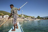 Man directing his boat - Lamakera Solor Island Indonesia