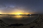 Milky Way and phosphorescent plankton - Hœdic France  ; Phosphorescent plankton light up the shore where small waves come to die. In the sky, the Milky Way Scorpio Swan.