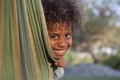 Portrait of girl in a hammock - Tanna Island Vanuatu ; 6 year old girl