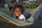 Girl in a hammock - Tanna Island Vanuatu ; 6 year old girl