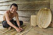 "Man weaving a traditional fish basket - Borneo Indonesia ; traditional fish basket ""Tangguk""<br>WWF-Indonesia"