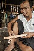 "Man carving traditional Dayak saber - Borneo Indonesia ; Traditional Dayak saber ""Mandau""<br>WWF-Indonesia"