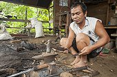 "Man forging a traditional Dayak saber - Borneo Indonesia ; Traditional Dayak saber ""Mandau""<br>WWF-Indonesia"