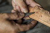 "Man carving a traditional Dayak saber - Borneo Indonesia ; Traditional Dayak saber ""Mandau""<br>WWF-Indonesia"