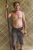 Man with traditional Dayak blowgun - Indonesia ; WWF-Indonesia