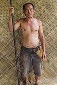 Man with traditional Dayak blowgun - Indonesia ; WWF-Indonesia