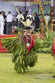 Masqked man wearing feather hornbill during Parade Hudoq ; Anniversary of Mahakam Hulu District<br>WWF-Indonesia