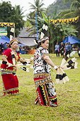 Women wearing feather hornbill - Dayak Parade Indonesia ; Tribal culture performance<br>Anniversary of Mahakam Hulu District<br>WWF-Indonesia