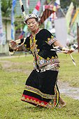 Woman wearing feather hornbill - Dayak Parade Indonesia ; Tribal culture performance<br>Anniversary of Mahakam Hulu District<br>WWF-Indonesia