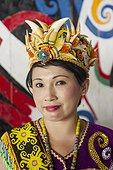 Woman wearing a traditional Dayak hat with sunbear teeth ; Batu Majang Long House<br>WWF-Indonesia