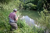 Man fly fishing - River Dessoubre France ; Fishing for European Grayling