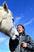 Horse psychologist and Camargue horse - Camargue France  ; Leslie Salut is a horse psychologist.