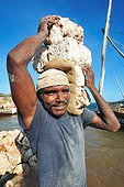 Loading of blocks of coral in a dhow - Lamu Kenya  ; for Lamu or some other towns of the Kenyan coast.