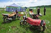 Motorcycles in a nomadic Tibetan herders camp - Tibet China