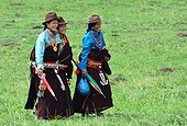 Women in traditional dress during Lapste - Tibet China ; Equestrian Festival Lapste