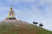 Rider and stupa at the Lapsté - Tibet China ; Equestrian Festival Lapste<br>Before racing, horse riders are praying the gods at the stupa made for the feast.
