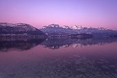 Sunset on Lake Annecy in winter - Alpes France  ; We recognize the mountains La Tournette and the Dents Lanfon.