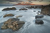 Laig Beach on the island of Eigg - Small isles Hebrides ; Rum Island is seen in front