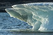 Summer sun light melting iceberg in Wager Bay, Ukkusiksalik National Park, Nunavut Territory, Canada