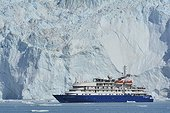 Denmark. Greenland. West coast. The Sea Explorer I, cruise boat, in front of the glaciar Eqip Sermia in the Quervain bay.