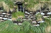 Denmark. Greenland. West coast. Traditionnal house protected by pit in the Inuit museum of the village of Aasiaat.