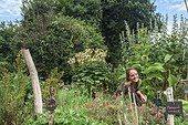 Young woman in a garden in agroecology