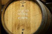 Eau de vie Vieille Prune aging in oak barrel, distillery G. Miclo , Lapoutroie , Alsace, France