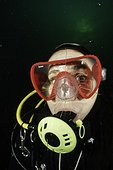 Scuba diver is watching a Craspedacusta sowerbii, freshwater jellyfish, phylum Cnidaria, invasive species. Lugano lake, Ticino, Switzerland