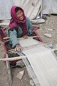 Samad woman weaving wool on a loom, Dipling, Highlands, Ladakh, Himalaya, India
