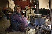 Elderly woman Samad inside a nomad tent, Dipling, Highlands, Ladakh, Himalaya, India