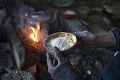 Man eating Tsampa in a nomad camp, Changthang Plateau, Ladakh, Himalayas, India