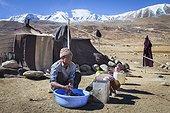 Man washing his clothes in a camp, Surroundings of Korzok, Leh, Ladakh, Himalayas, India