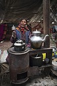 Woman with prayer wheel inside a Yack wool tent, Surroundings of Korzok, Leh, Ladakh, Himalayas, India