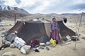 Elderly woman in front of tent in camp, Surroundings of Korzok, Leh, Ladakh, Himalayas, India