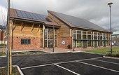 Thin film solar PV panels on Bloor Community Centre Zero Carbon Village Stoke Orchard Cheltenham UK