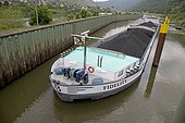 Barge transporting coal on Mosel River, Germany